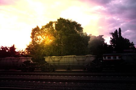 A colorful sunup above a small train station in thailand , Effect Golden light