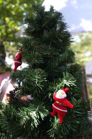 Santa doll on the Christmas tree close-up  Stock Photo