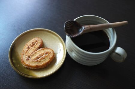 Cookies in the form of heart with coffee . Copy text menu food background.
