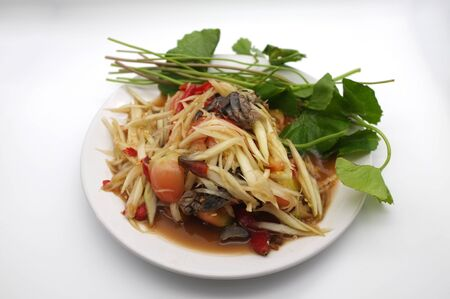 Som tam thai, green papaya salad on white background