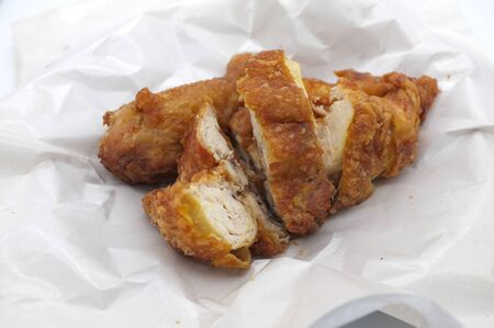 Hot and crispy fried chicken on white paper