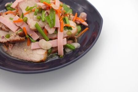Spicy salad of roasted pork on white background , Thai style food Standard-Bild