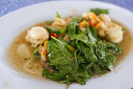 THAI SEAFOOD , Basil fried scallops Stockfoto