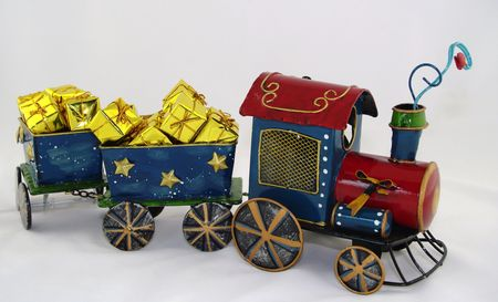 Model steam train pulling wagons full of gold presents photo