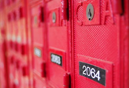 Red Post Office Box with numbers Stock Photo