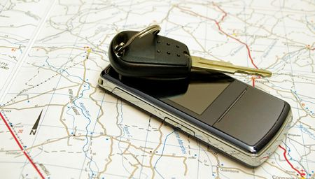 Car Key and Mobile phone on road map
