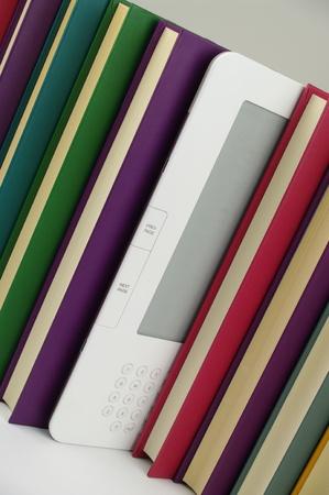 e book and row of coloured books photo