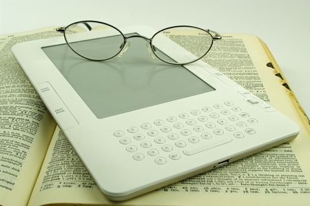 e book with spectacles and dictionary photo