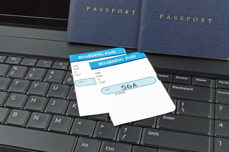 passports computer and boarding passes