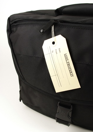 black travel bag and lost identification tag