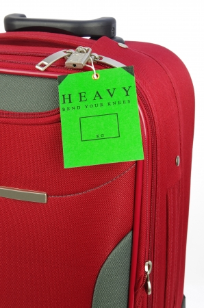 red travel case with green warning label photo