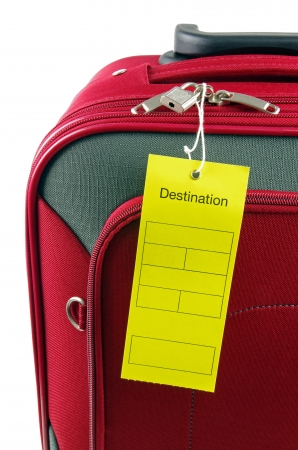 luggage tag: destination lable and red travel case