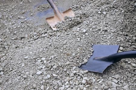 shovels digging in gravel