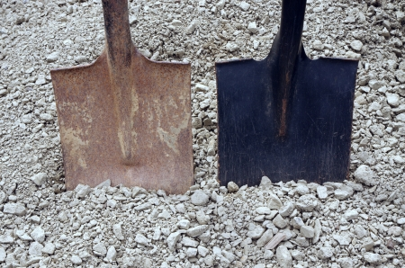 two shovels and gravel photo