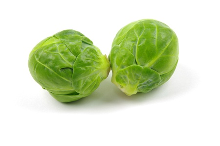 two brussel sprouts on white background