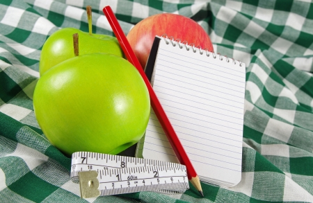 note pad: fruit with note pad and measuring tape
