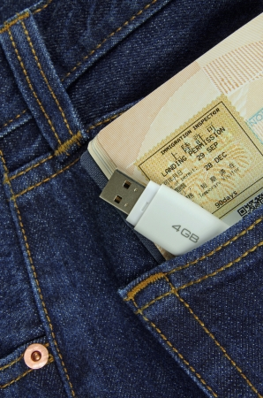 memory stick and passport in a pocket