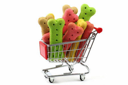 colored dog biscuits and shopping cart