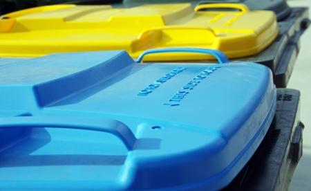 row of coloured rubbish bins