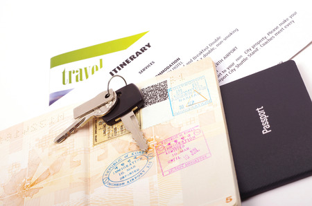 travel documents passport and car keys photo