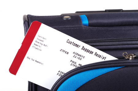baggage: airline baggage receipt and travel bag