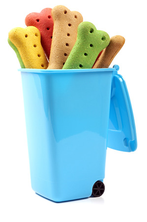 dog biscuits inside a blue wheelie bin