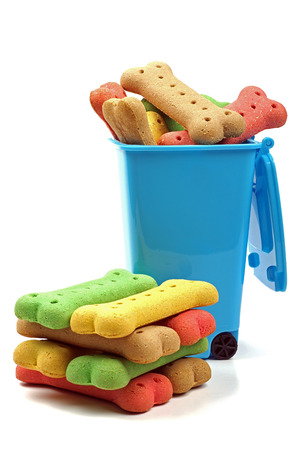 blue rubbish bin and a stack of dog bones