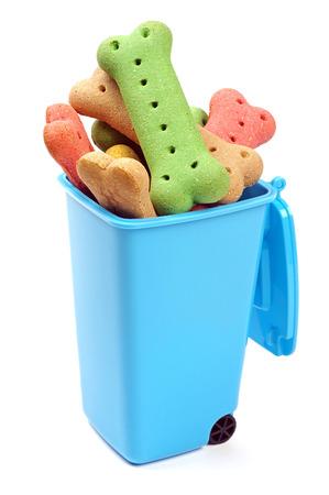 blue bin full of coloured dog treats