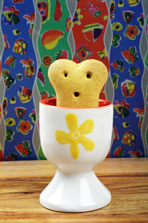 dog breakfast biscuit and egg cup Stock Photo