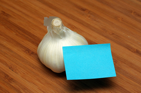 garlic bulb and blue sticky note Stock Photo