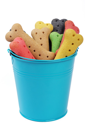 bucket of colored dog biscuits Stock Photo