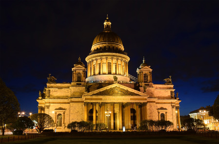martha: St. Isaacs Cathedral in May, night, illuminated against the dark sky and bright lights Stock Photo