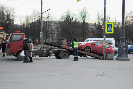 trespasser: ST.PETERSBURG, RUSSIA - MARCH 13, 2016: The tow truck and the traffic police evacuated the car with a pedestrian crossing on the Moscow square Editorial