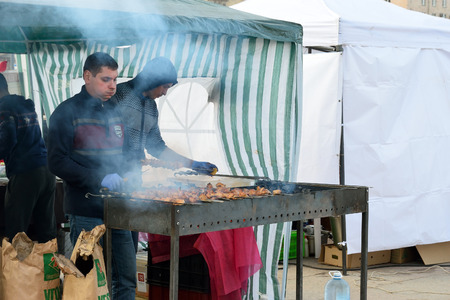 maslenitsa: ST.PETERSBURG, RUSSIA - MARCH 13, 2016: The chef is grilling shish kebabs in the grill on the street on the holiday of Maslenitsa at Moscow square