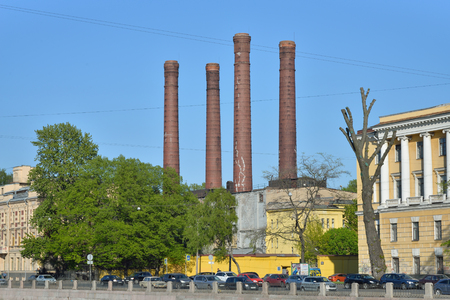 boiler house: Four brick chimneys of boiler house on the Fontanka embankment  in Saint-Petersburg