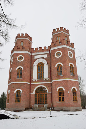 ski traces: Red brick building with four towers - the Arsenal in the Alexander Park in Pushkin in winter.