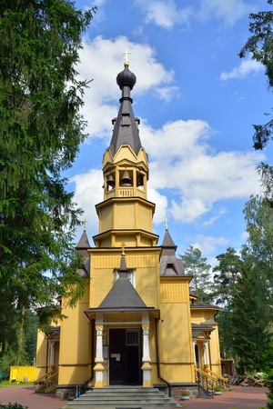 apostle paul: View of the entrance Bell tower of the Church of the Holy apostles Peter and Paul in the village of Vyritsa in the Leningrad region in summer Sunny day .