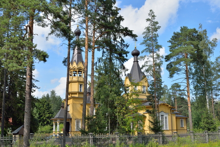 apostle paul: Church of the Holy apostles Peter and Paul outside the fence in the village of Vyritsa in Siverskiy the highway in Leningrad region in summer Sunny day . Stock Photo