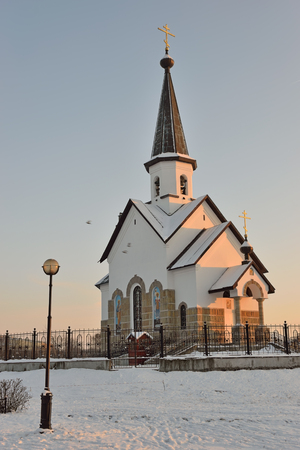 christmas grounds: The Church of St. George in Pulkovskom Park in St. Petersburg   in winter on a Sunny day