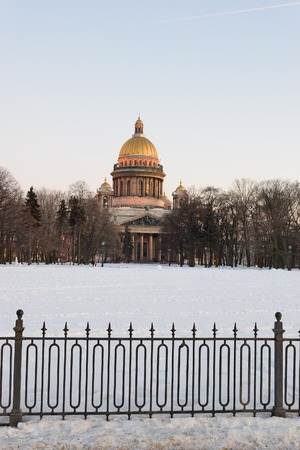 View of St. Isaacs Cathedral and the fence of Alexander garden with Admiralty embankment in winter in St. Petersburg