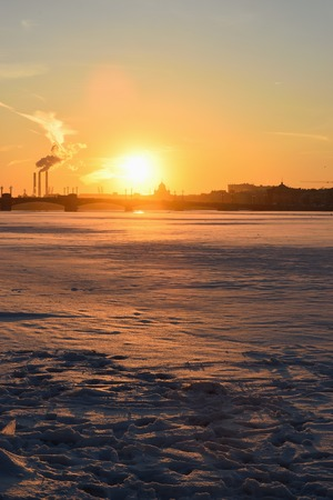 neva: Sunset on the Neva river at the Admiralty embankment in winter in St. Petersburg