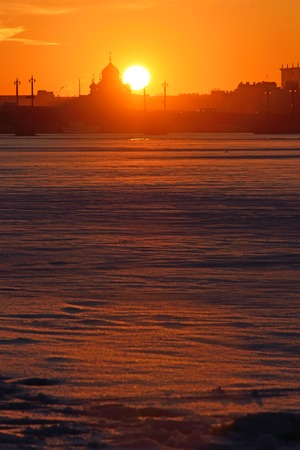 river banks: Sunset on the Neva river at the Admiralty embankment in winter in St. Petersburg