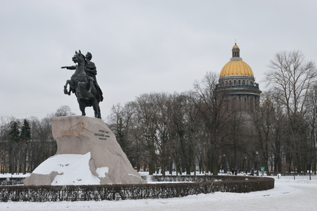peter the great: Monument to Peter the great bronze Horseman and St. Isaacs Cathedral in winter, St. Petersburg Stock Photo