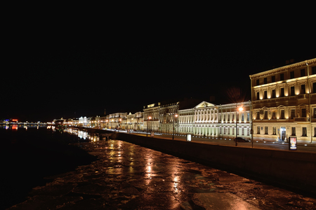 blagoveshchensky: Night view on English embankment and Neva river with floating ice floes with Blagoveshchensky bridge in St. Petersburg Stock Photo