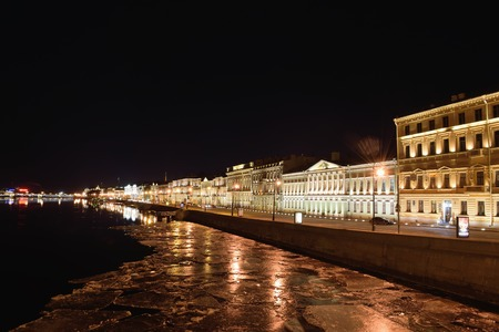 Night view on English embankment and Neva river with floating ice floes with Blagoveshchensky bridge in St. Petersburg Stock Photo