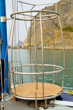 Metal pole for a Striptease on a yacht. Crimea. Stock Photo