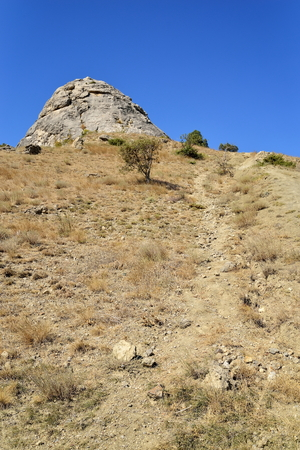 a slope: Mountain trail on a rocky slope. Crimea Stock Photo