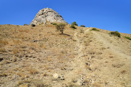 slope: Mountain trail on a rocky slope. Crimea Stock Photo