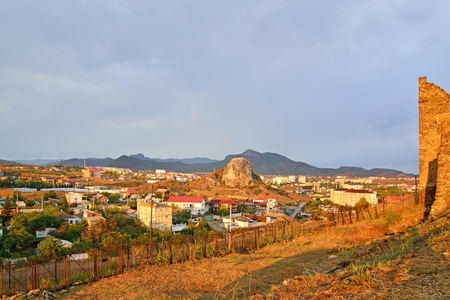sudak: A view of the city of Sudak and the Genoese fortress at sunset. Crimea