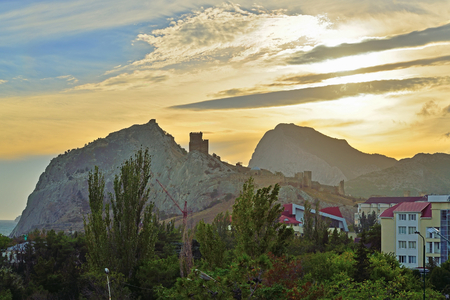 sudak: View of Sudak and Genoese fortress at sunset. Crimea